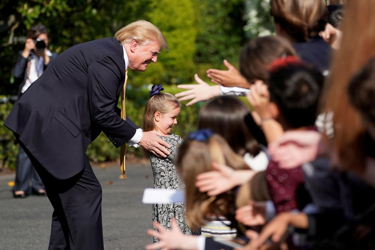 US President Donald Trump poses for a selfie as he hosts Take Our Daughters and Sons to Work Day.
