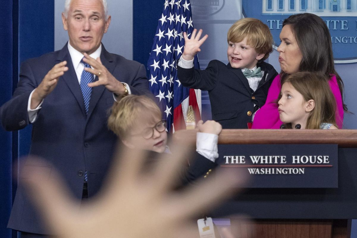 Vice-President Mike Pence, along with White House Press Secretary Sarah Huckabee Sanders with her daughter Scarlett and sons Huck (left) and George, takes questions from children of White House staff and journalists.