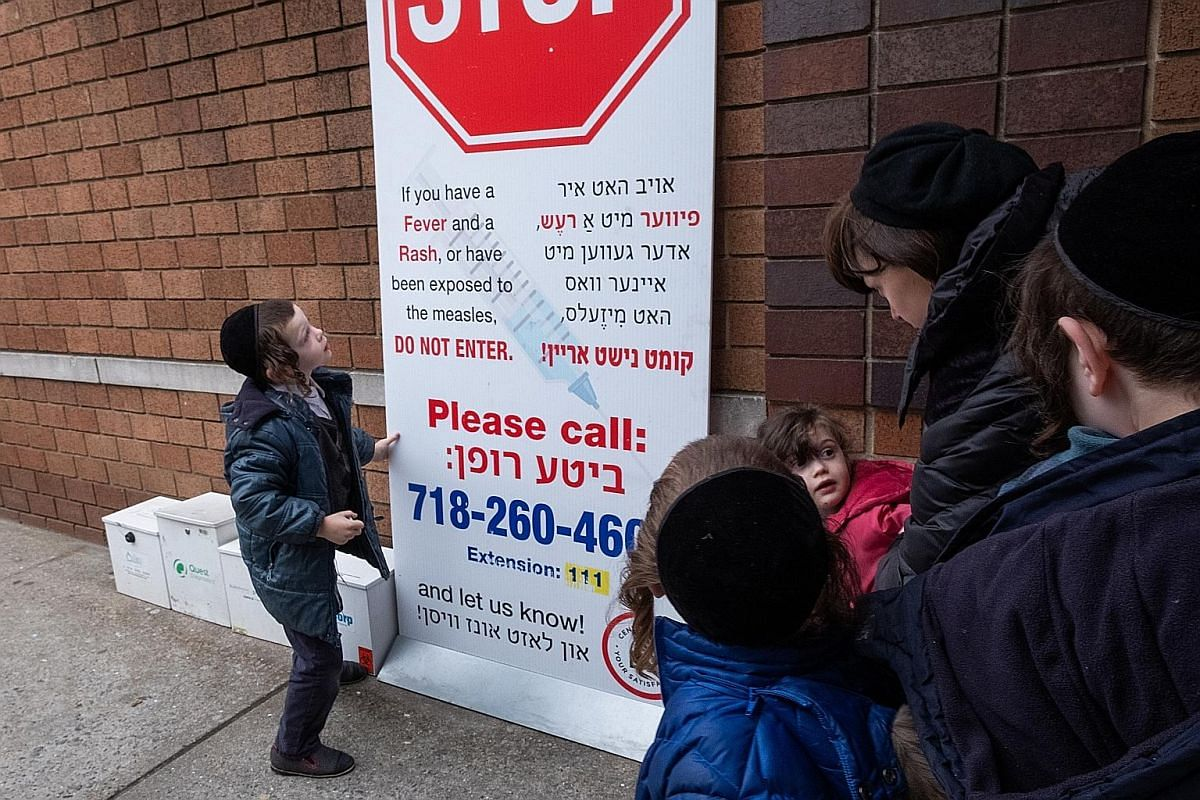 New York City Mayor Bill de Blasio declaring a public health emergency earlier this month in parts of Brooklyn in response to a measles outbreak. Unvaccinated members of the Orthodox Jewish community living in the affected areas were required to get