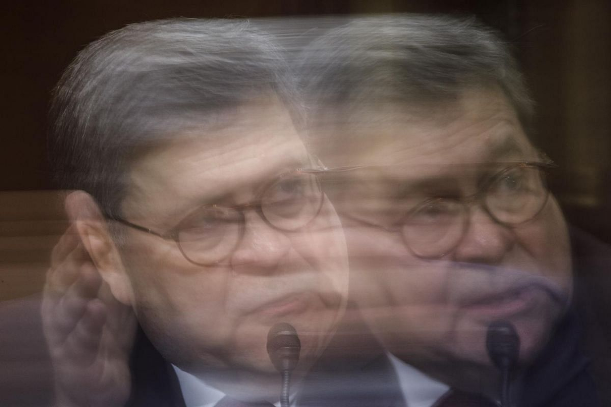 A picture taken with slow shutter speed shows US Attorney General William Barr testifying before the Senate Judiciary Committee on Capitol Hill in Washington, DC, on May 1, 2019.