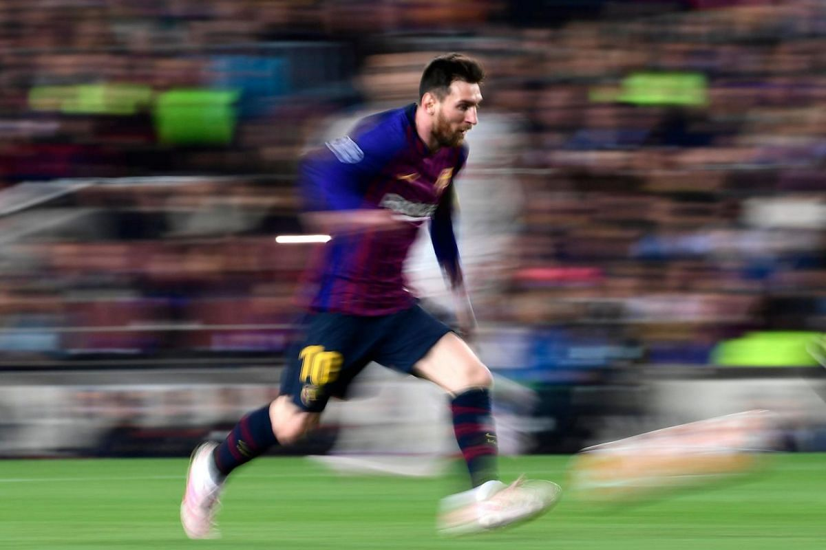 Barcelona's Argentinian forward Lionel Messi runs with the ball during the UEFA Champions League semi-final football match against Liverpool at the Camp Nou stadium in Barcelona, Spain, on May 1, 2019.