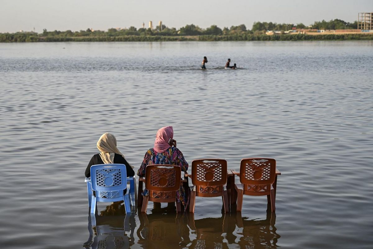 A Sudanese family at the Tuti island where the Blue Nile and the White Nile meet to form the Nile river, in Khartoum, Sudan, on May 1, 2019.