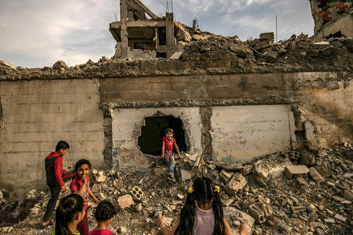 Children play among debris in the northern Syrian city of Raqqa, the former Syrian capital of the Islamic State group, on May 1, 2019.