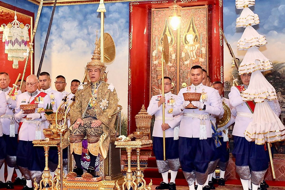 Thai King Maha Vajiralongkorn wearing a crown while sitting on the throne during his coronation ceremony at the Grand Palace in Bangkok.