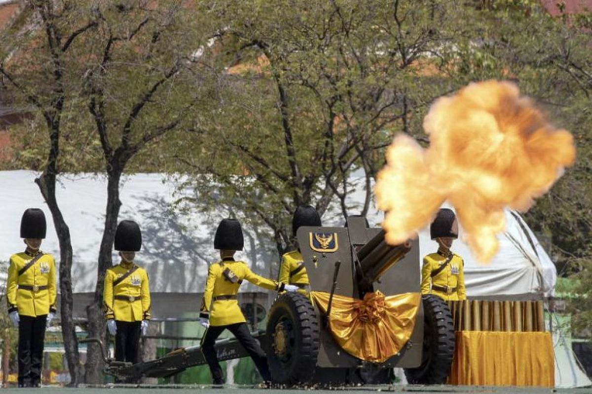 Thai royal guards fire an artillery gun salute during the coronation ceremony of Thai King Maha Vajiralongkorn.