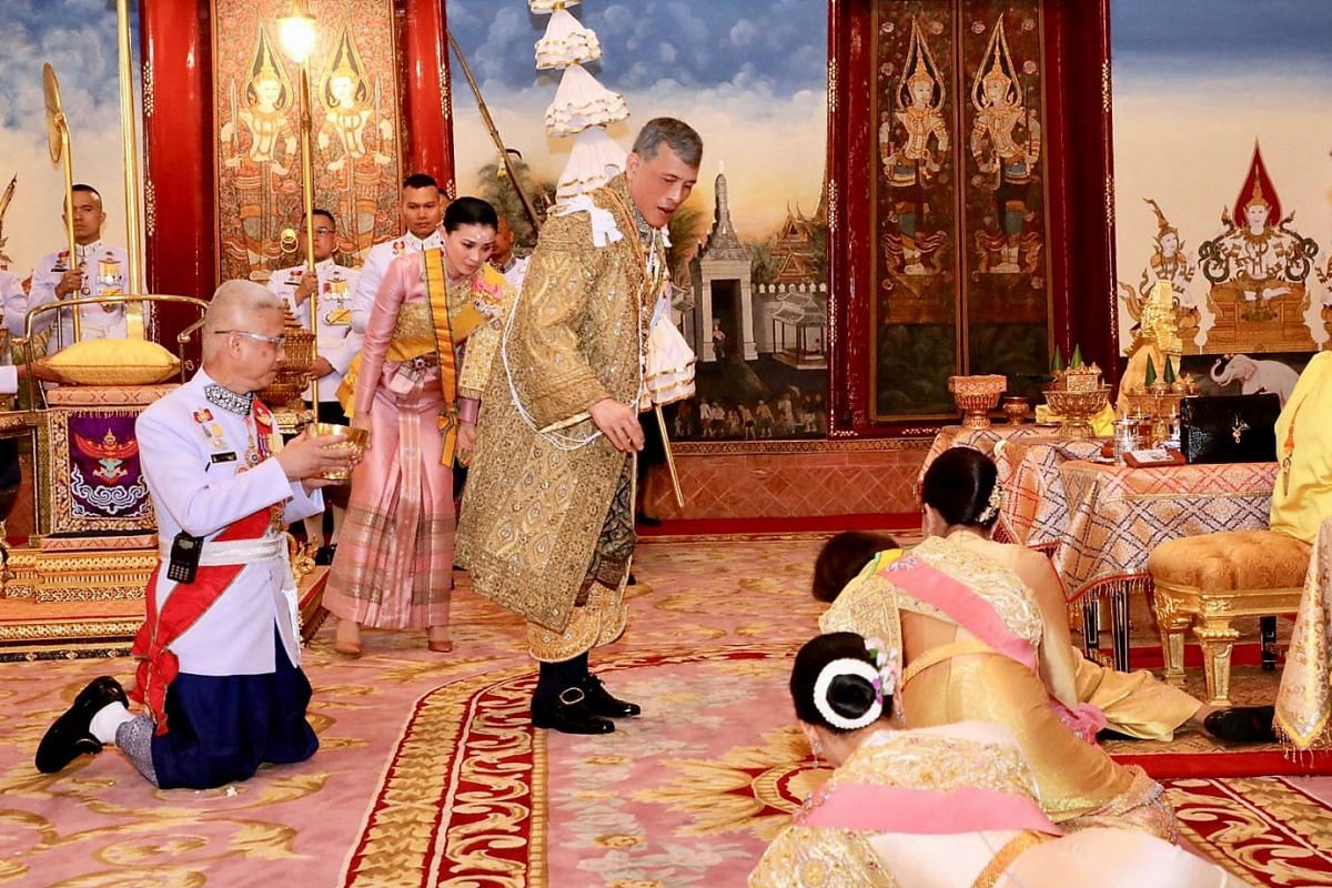Thai King Maha Vajiralongkorn being greeted by members of the royal family during the coronation ceremony on May 4, 2019.