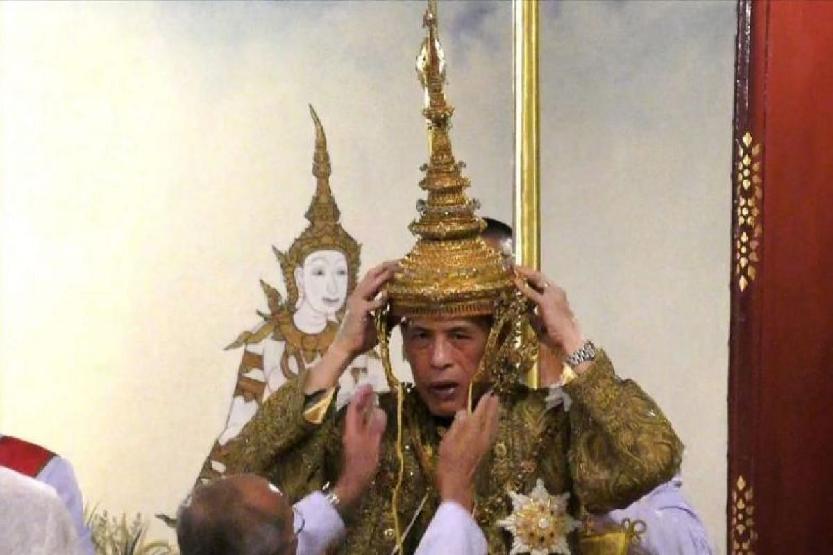 Thai King Maha Vajiralongkorn being crowned during his coronation ceremony in Bangkok.