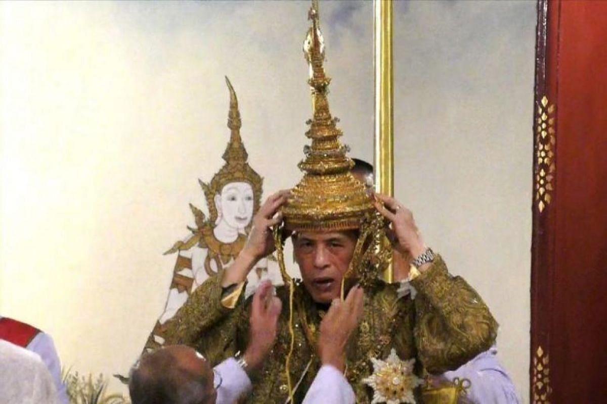 Thai King Maha Vajiralongkorn being crowned during his coronation ceremony in Bangkok.