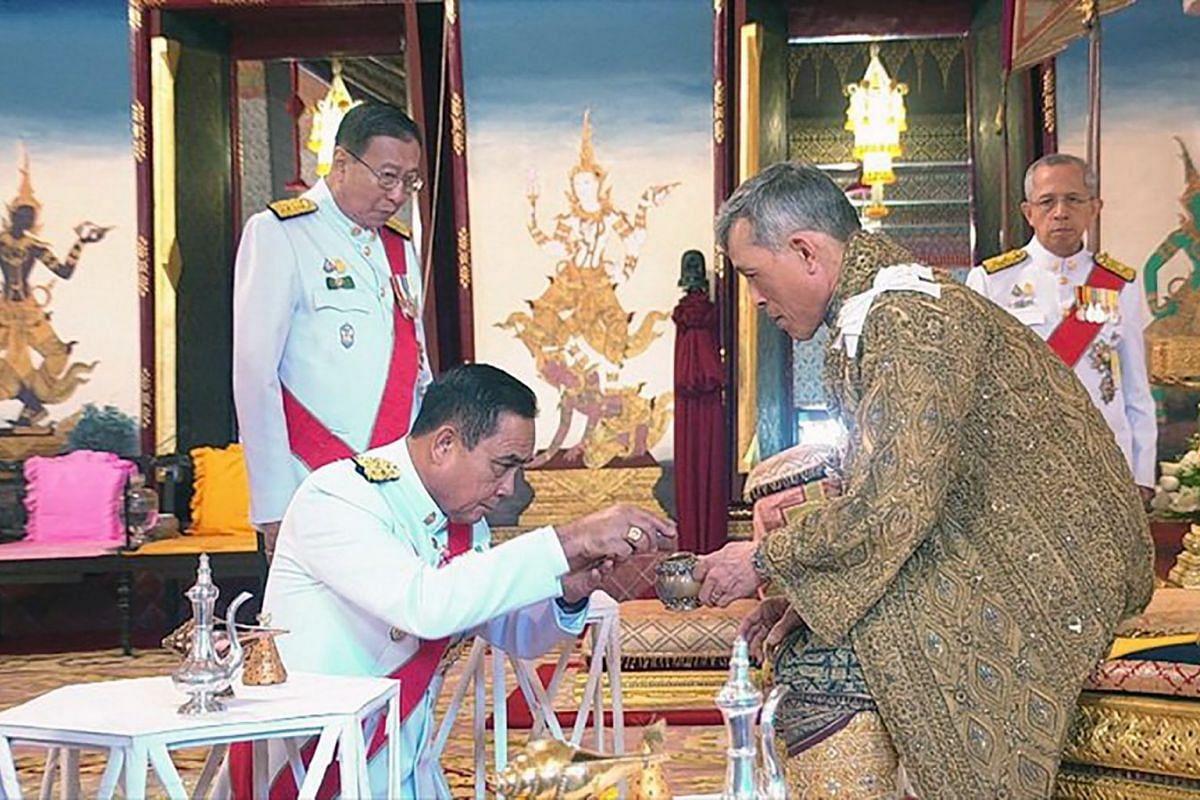 Thai Prime Minister Prayut Chan-o-cha paying respects to King Maha Vajiralongkorn during the coronation ceremony at the Grand Palace on May 4, 2019.