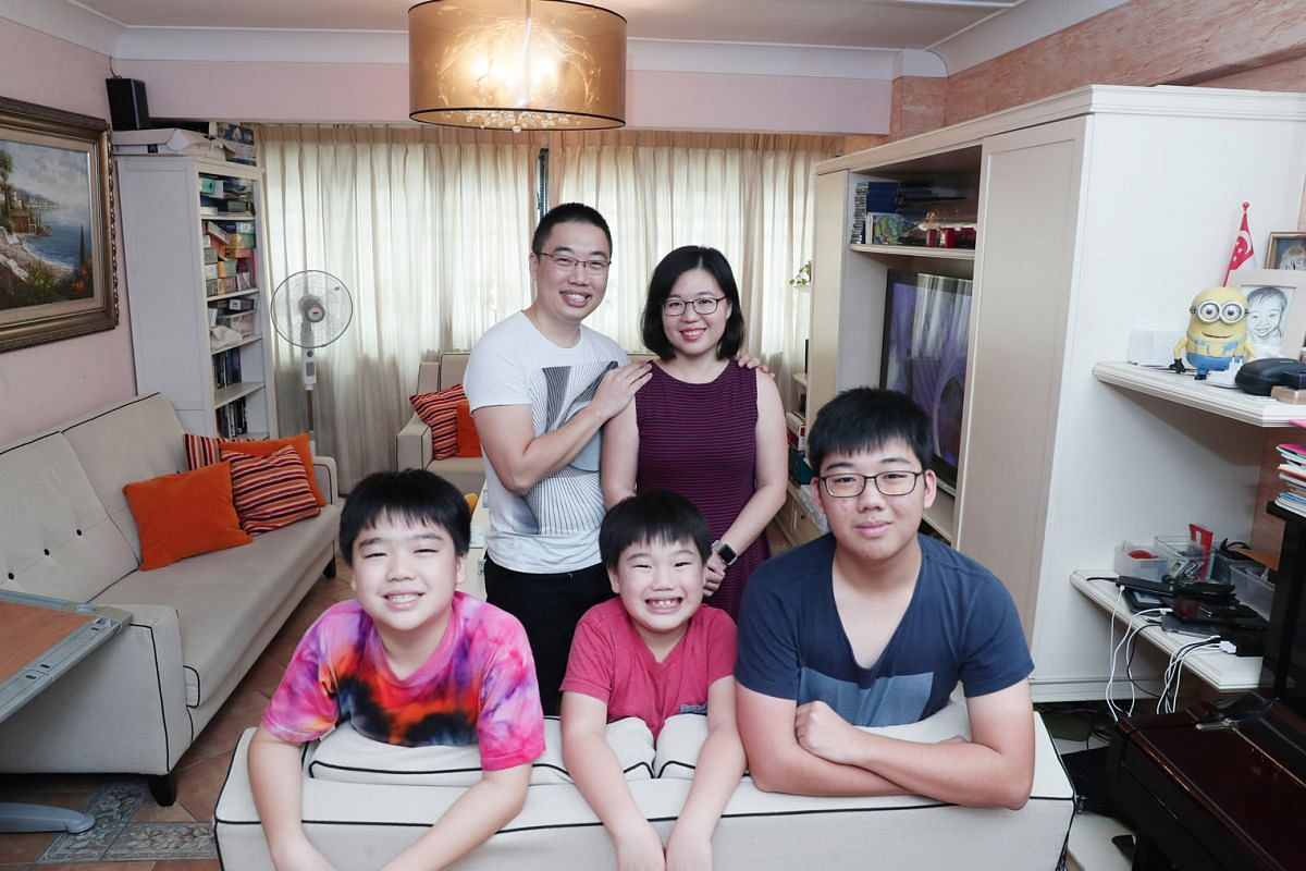 Mr Joseph Gan and his wife, Ms Tay Li Ping, live with their sons (front row, from left) Daniel, 11; Gabriel, seven; and Joshua, 16, in a five-room flat in Clementi. The couple are also foster parents to two boys.