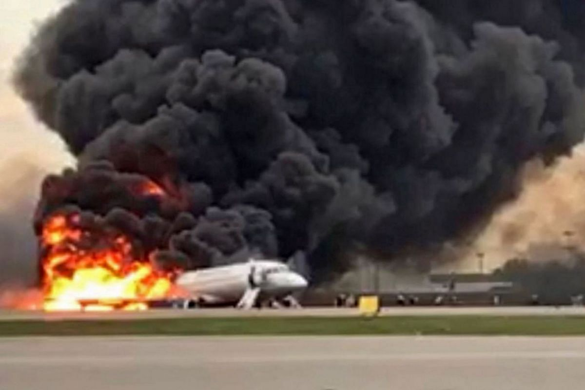 A handout photo made available by Russian Investigative Committee (Sledcom) shows a Sukhoi Superjet 100 of Russian airline Aeroflot burning at Moscow's Sheremetyevo airport, Russia, May 5, 2019. HANDOUT VIA EPA-EFE