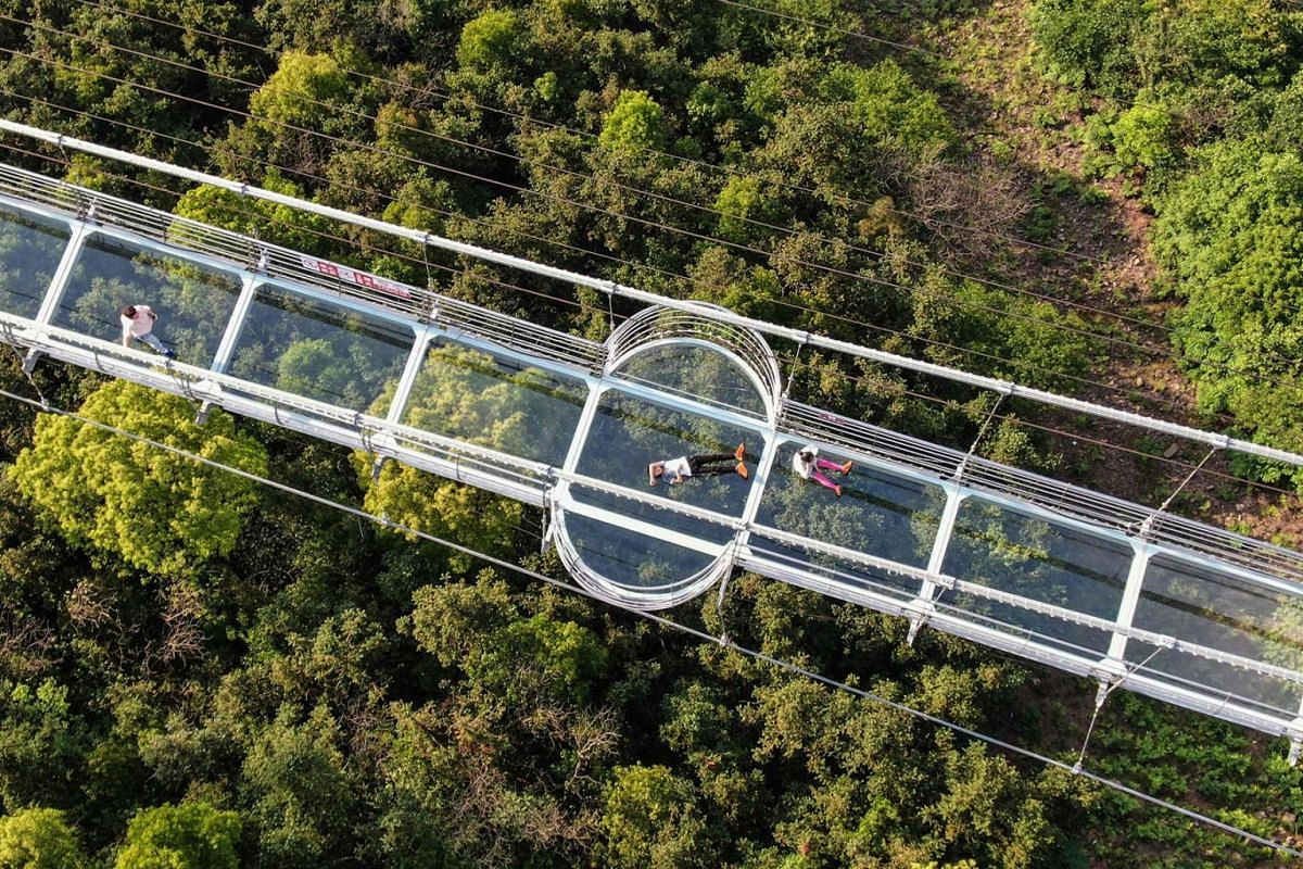 This aerial photo taken on May 4, 2019 shows people visiting a 518-meter-long glass-bottomed skywalk at Huaxi Adventure Park in Jiangyin in China's eastern Jiangsu province, during a four-day national holiday marking May Day. PHOTO: AFP
