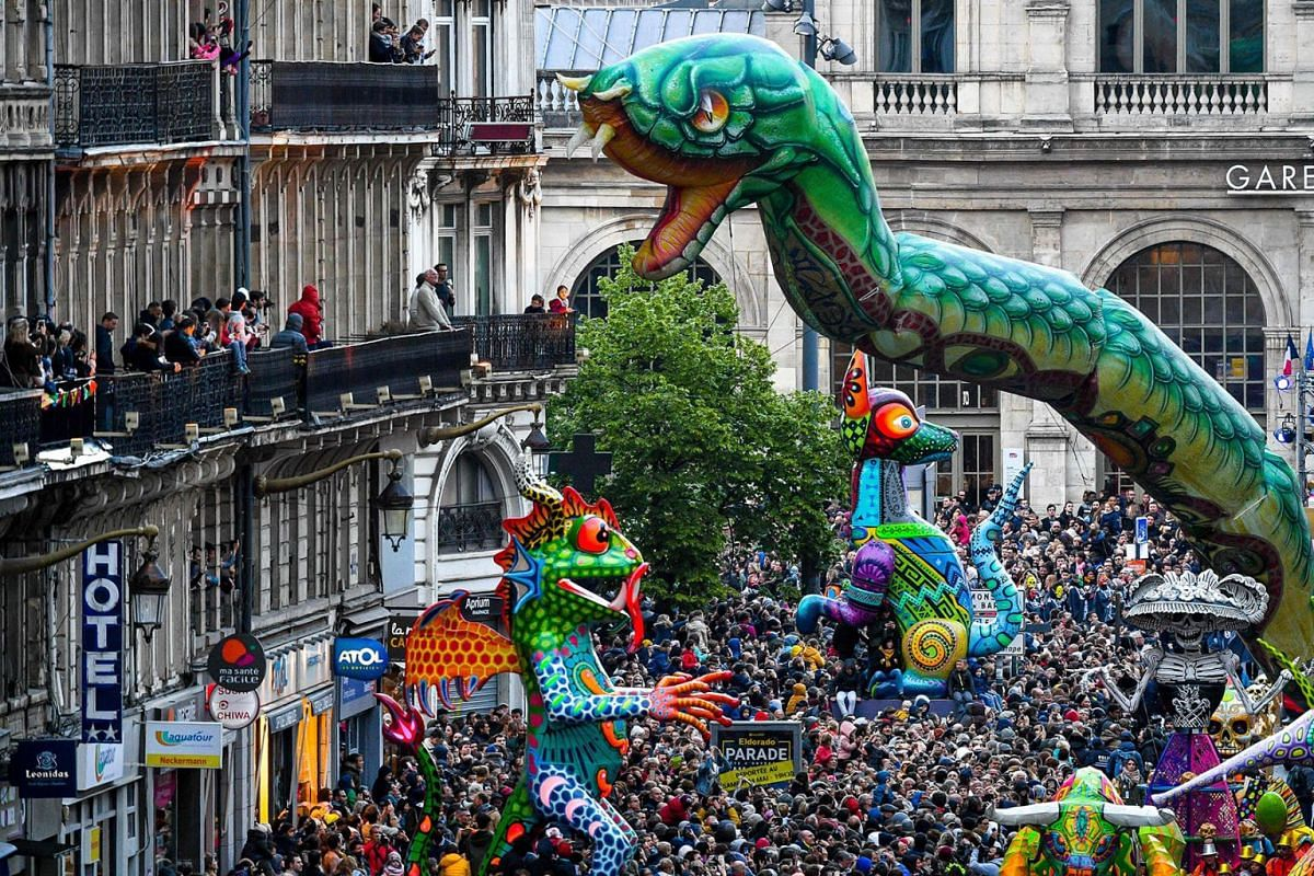 """People watches the Eldorado parade in Lille, northern France, on May 4, 2019 during the Lille 3000 event with """"Mexico"""" as this year's theme. PHOTO: AFP"""
