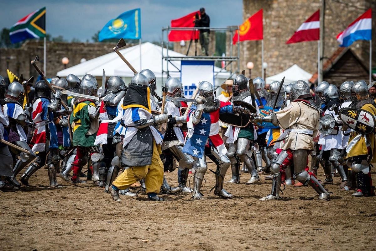"""Female enthusiasts wearing armour fight during the medieval tournament """"Battle of the Nations"""" at the Smederevo fortress, in eastern Serbia, on May 5, 2019. PHOTO: AFP"""