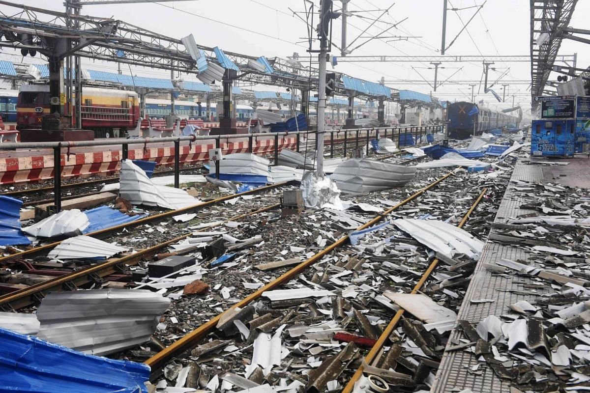 Debris litters the train tracks at the damaged railway station in Puri in the eastern Indian state of Odisha on May 4, 2019.