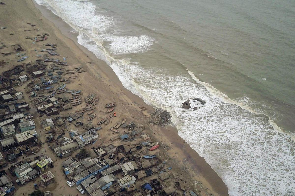 Damaged homes and fishing boats are left behind along the coastline in Puri, India, on May 5, 2019.