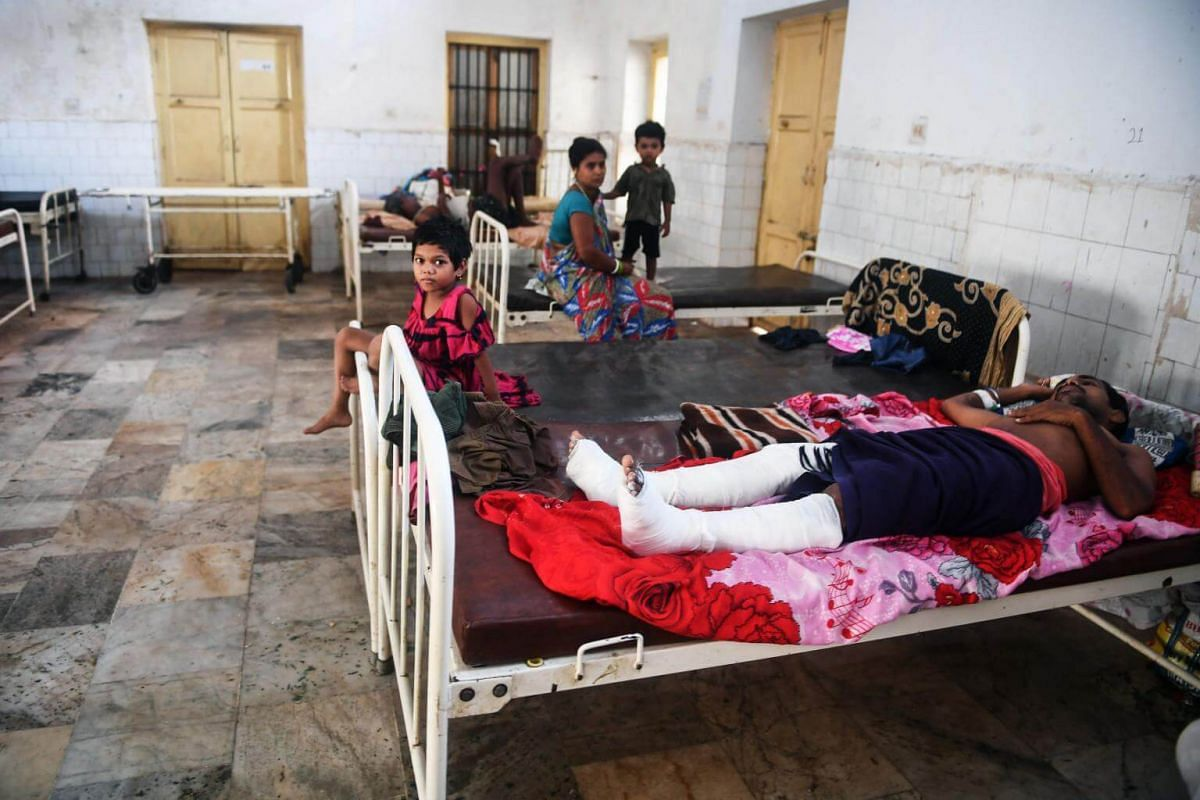 Injured people rest at the district hospital in Puri on May 5, after Cyclone Fani swept through India's Odisha state.