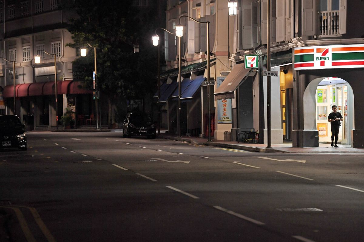 Bright lights at a 7-Eleven shop at the corner of McCallum and Stanley streets illuminate an almost traffic-free lane.