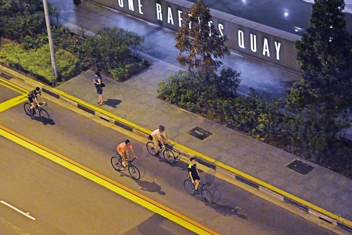 As traffic thins and cars all but disappear from Raffles Quay at night, it is the turn of cyclists to take to the streets.