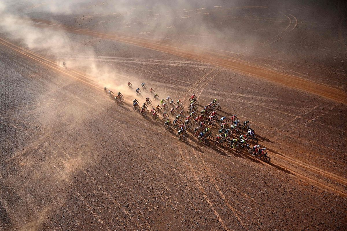 Competitors ride their bikes during Stage 4 of the 14th edition of Titan Desert 2019 mountain biking race between Merzouga and M'ssici, in Morocco, on May 1, 2019.