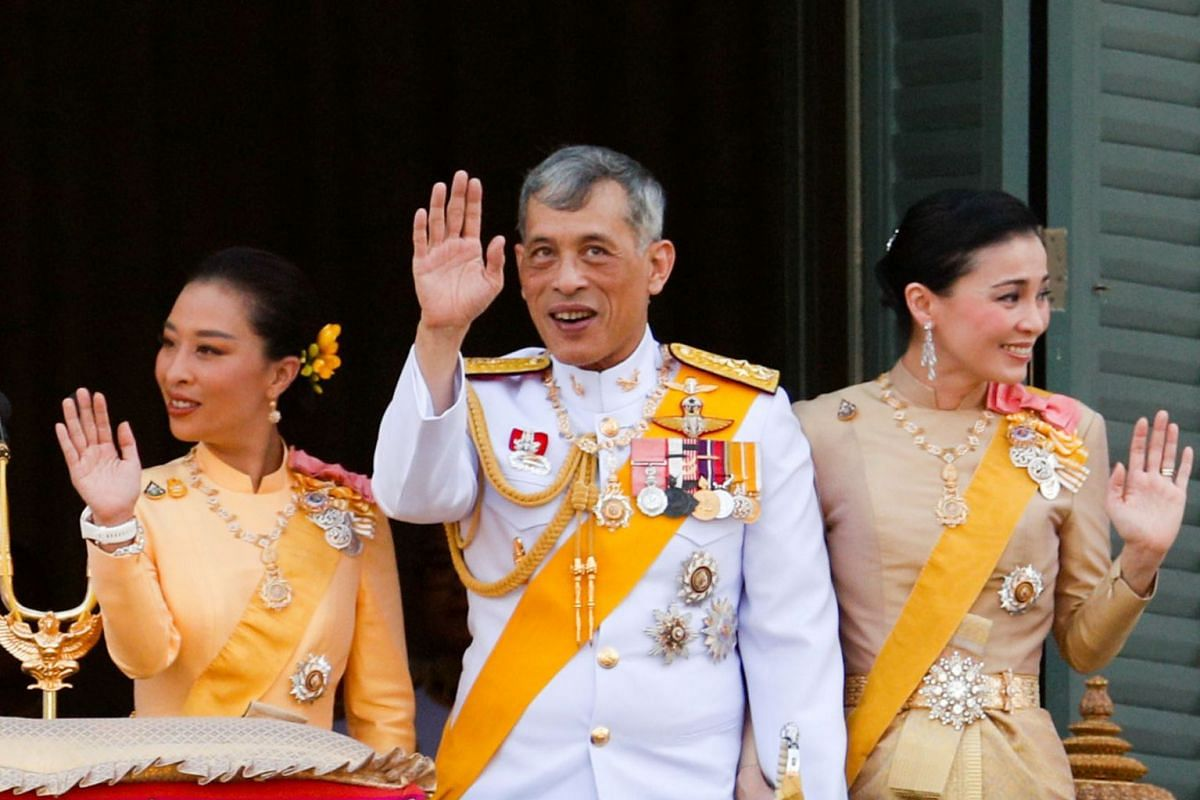 Thailand's newly crowned King Maha Vajiralongkorn, Queen Suthida and Princess Bajrakitiyabha are seen at the balcony of Suddhaisavarya Prasad Hall at the Grand Palace where King grants a public audience to receive the good wishes of the people in Ban