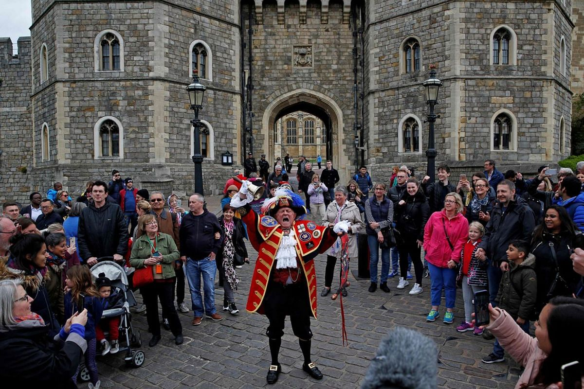 Town crier, Tony Appleton poses as he announces the birth of a son for Britain's Prince Harry, and Duke of Sussex, and his wife Meghan, Duchess of Sussex, outide of Windsor Castle in Windsor, west of London on May 6, 2019. PHOTO: AFP