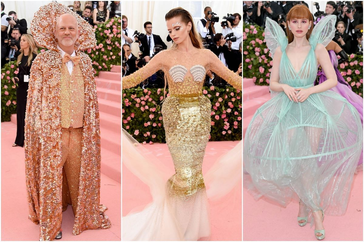 (From left) Showrunner Ryan Murphy, model Abbey Lee Kershaw and actress Madelaine Petsch arrive for the Met Gala at the Metropolitan Museum of Art on May 6, 2019.