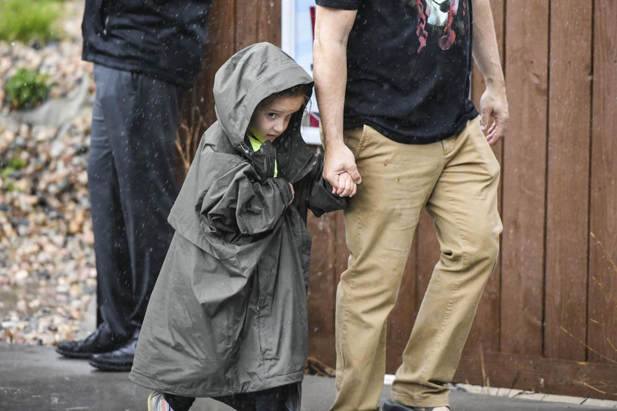 A child walking out of the Recreation Centre in Northridge, where students who were not injured had been evacuated to after the school shooting in Highlands Ranch, Colorado.