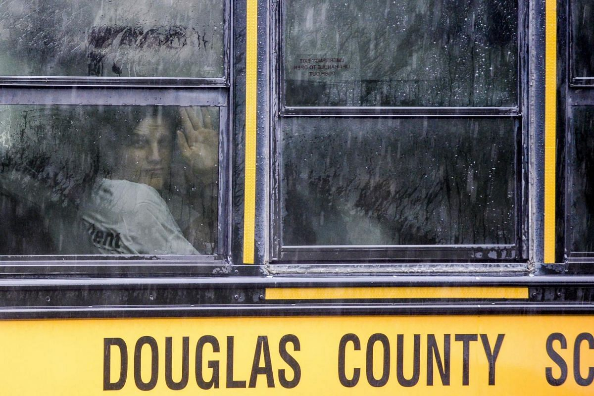 A bus transporting students to the Recreation Centre in Northridge, after at least seven students were injured during a shooting at STEM School Highlands Ranch.