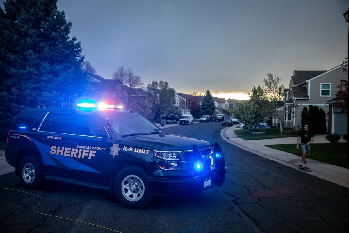 Police outside the home of one of the alleged gunmen involved in the STEM School Highlands Ranch shooting in Highlands Ranch, Colorado.