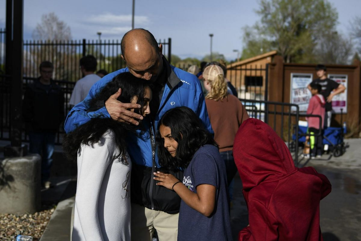 Mr Mahesh Anandan with his children after he had picked them up from the Northridge Recreation Centre in Highlands Ranch, Colorado.