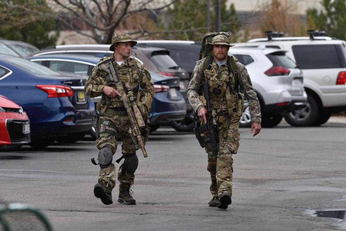 Officers patrolling the area after the school shooting in Highlands Ranch, Colorado.