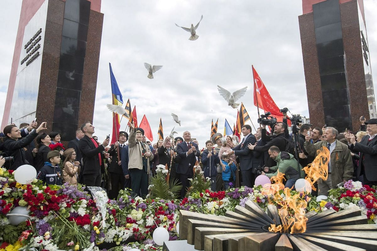 The president of Moldova Igor Dodon (centre) with veterans release the pigeons at the Eternal Flame during celebrations to mark the 74th anniversary of Victory Day, at the Victory Memorial in Chisinau, Moldova, May 9, 2019. Former Soviet Republics on