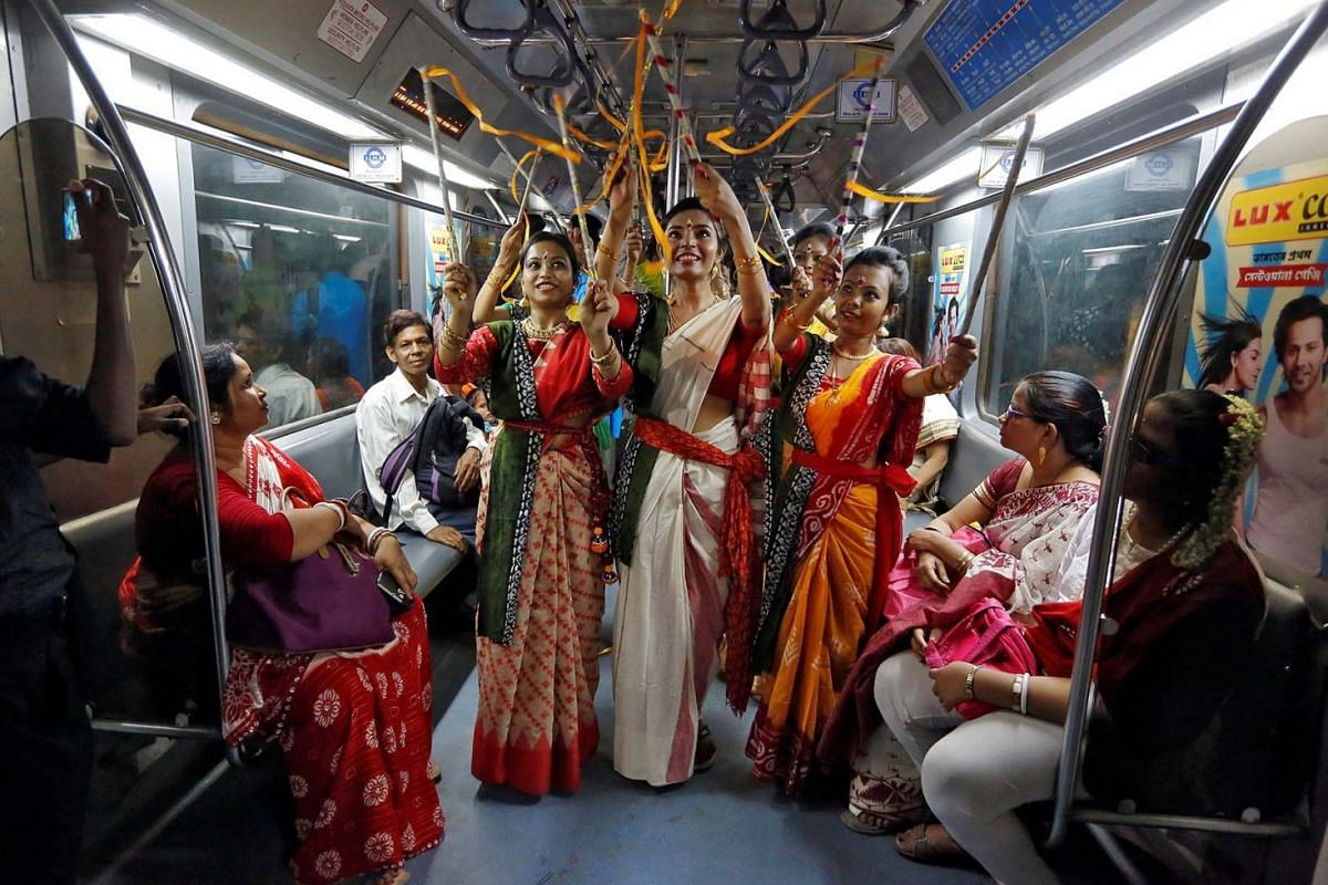 Women, who according to the organisers are suffering from Thalassaemia, perform inside a running Metro train to celebrate the 158th birth anniversary of Nobel Prize winning poet Rabindranath Tagore in Kolkata, India, May 9, 2019.
