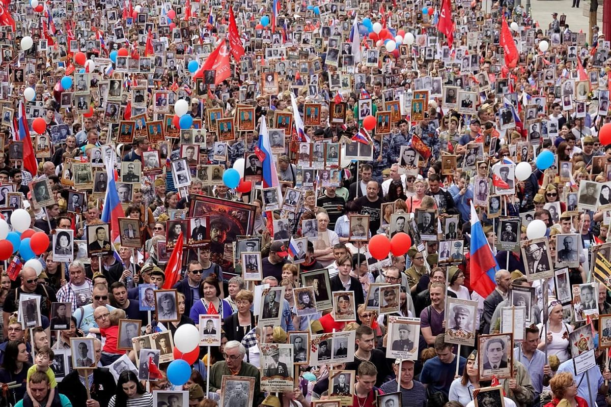 Participants carry portraits of people, including Red Army soldiers, during the Immortal Regiment march on the Victory Day, marking the anniversary of the victory over Nazi Germany in World War Two, in central Moscow, Russia May 9, 2019.