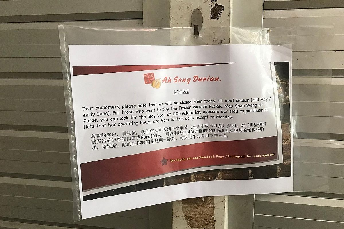 A notice informing customers that Ah Seng Durian, a popular stall at Ghim Moh market, will be closed until mid-May or early June.