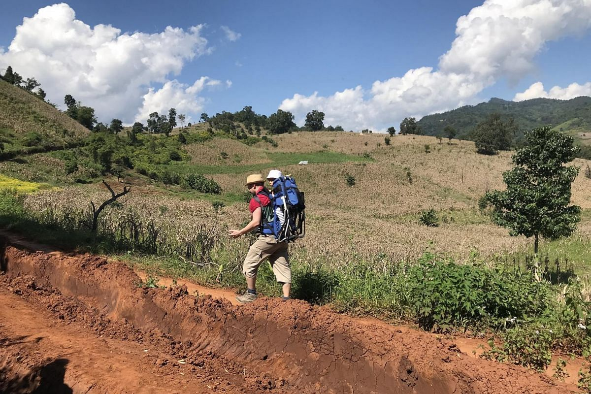 During the two-day trek in northern Shan State, the writer and her husband took turns carrying Elna in a hiking baby carrier.