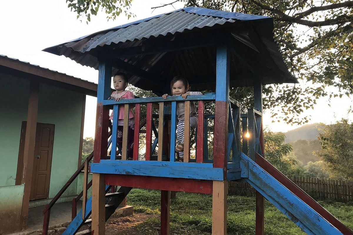 Elna making friends in a school playground in the Palaung village of Pan Kam.