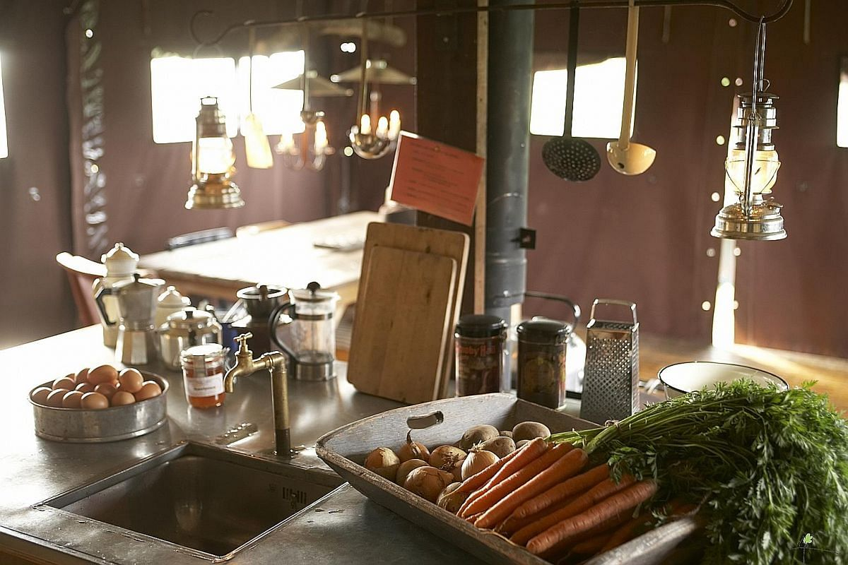 Cooking on a wood-fired stove can be a challenge, but all the produce is fresh off the farms.