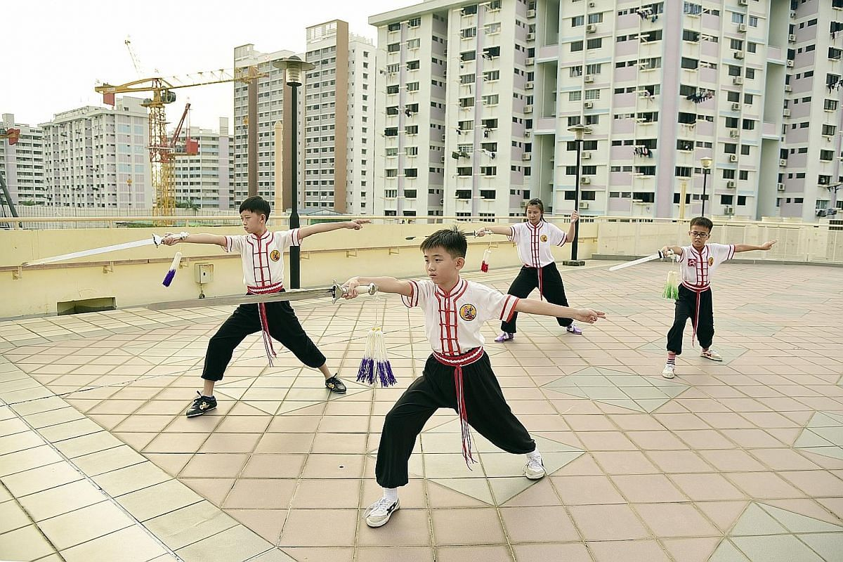 Children practising wushu during a class on the rooftop of Mountbatten Community Club (CC). Since the club ceased operations, classes are now being held at Old Airport Road food centre.