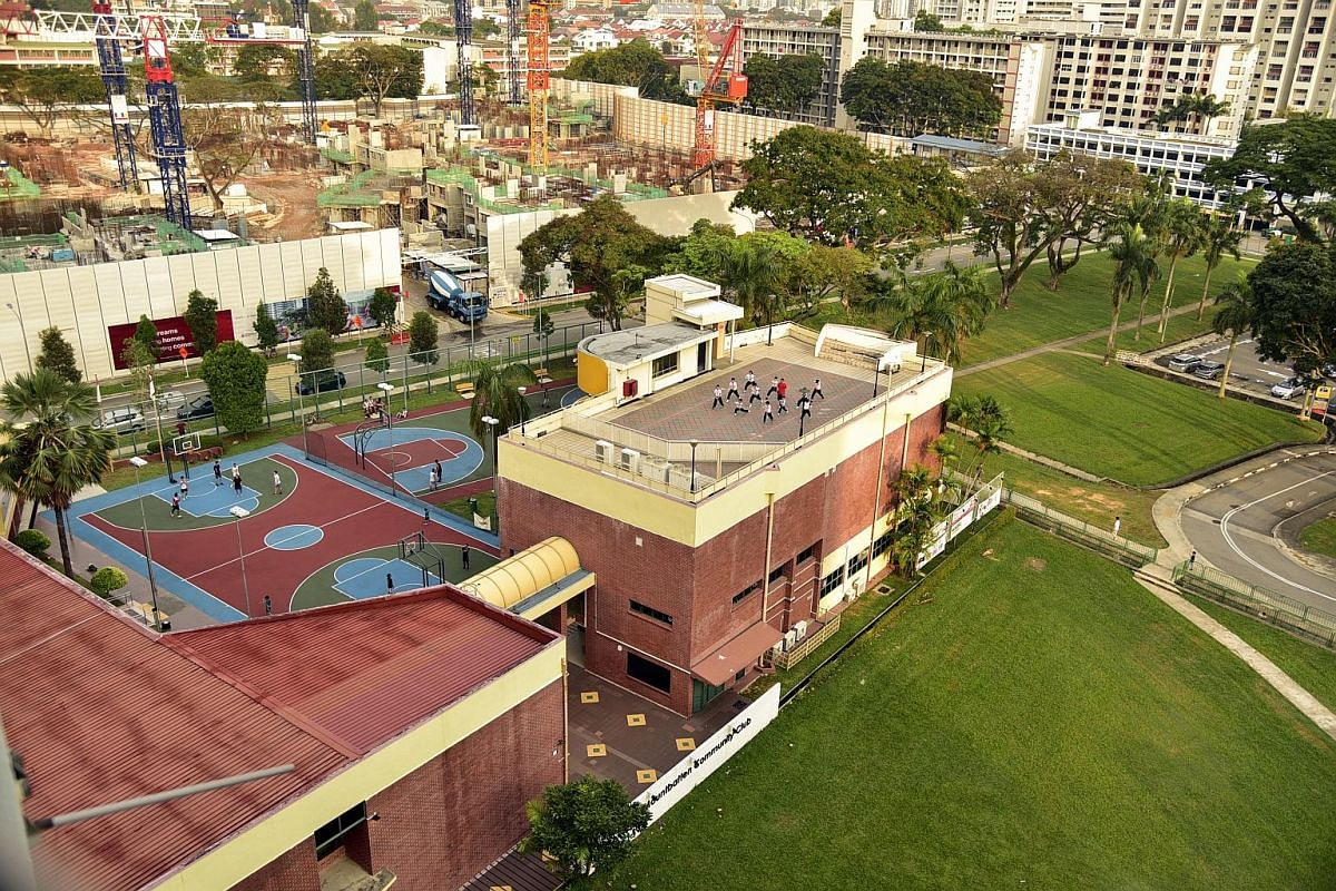 A bird's-eye view of Mountbatten CC from Block 42 Cassia Crescent, showing a wushu class for children taking place on the rooftop of the 38-year-old club. A new club will open near the original location to serve residents.