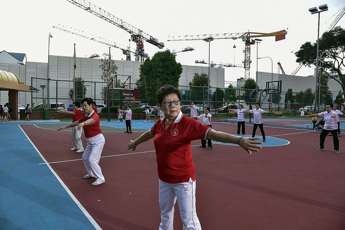 Madam Ng Geok Hoon (centre), and Madam Lim Eng (beside Madam Ng), both 77, are members of the Qigong Shi Ba Shi Association who have been practising qigong for 32 years every morning at the club, except on Sundays and public holidays.