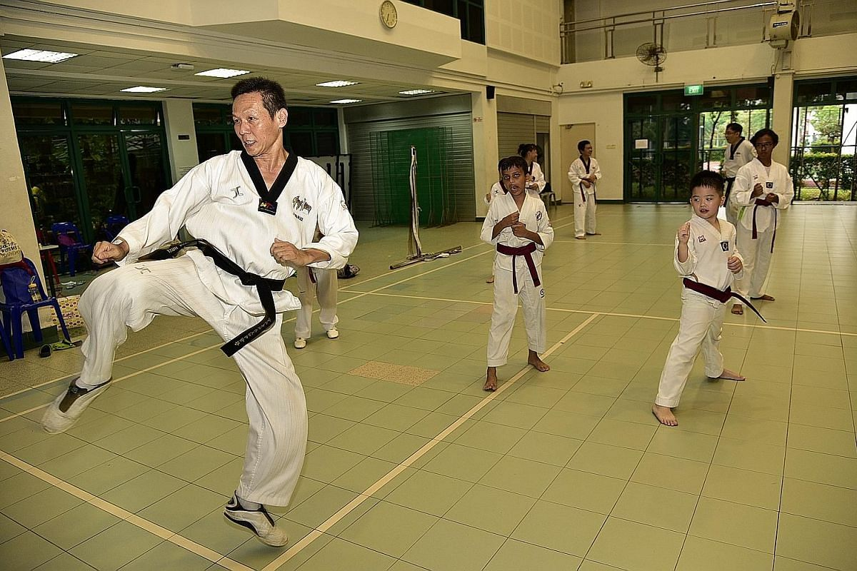 Seventh-dan taekwondo black-belt instructor Darran Lee, 55, holding a class at the club. A taekwondo referee in the 2008 Beijing Olympic Games, he taught many children for over a decade at the multipurpose hall in Mountbatten CC.