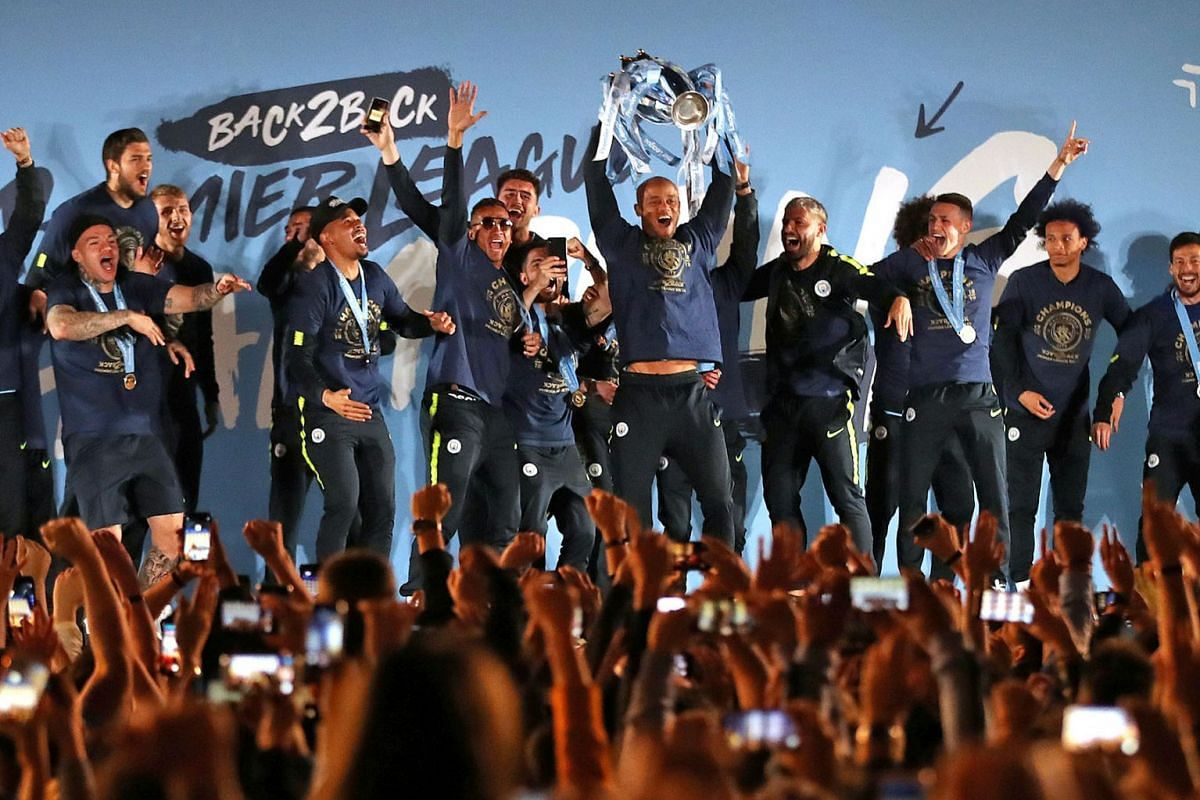 Manchester City players celebrate winning the Premier League as they show the Premier League trophy to supporters at the Etihad Stadium in Manchester, Britain on May 12, 2019. PHOTO: ACTION IMAGES VIA REUTERS