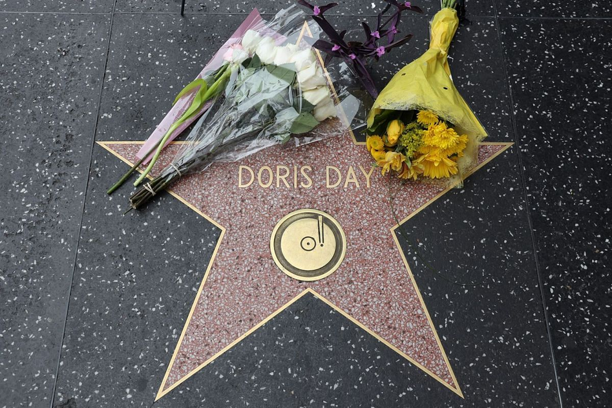 Flowers left by fans rest on the Walk of Fame star for US actress/singer Doris Day in Hollywood, California, USA, May 13, 2019 PHOTO: EPA-EFE
