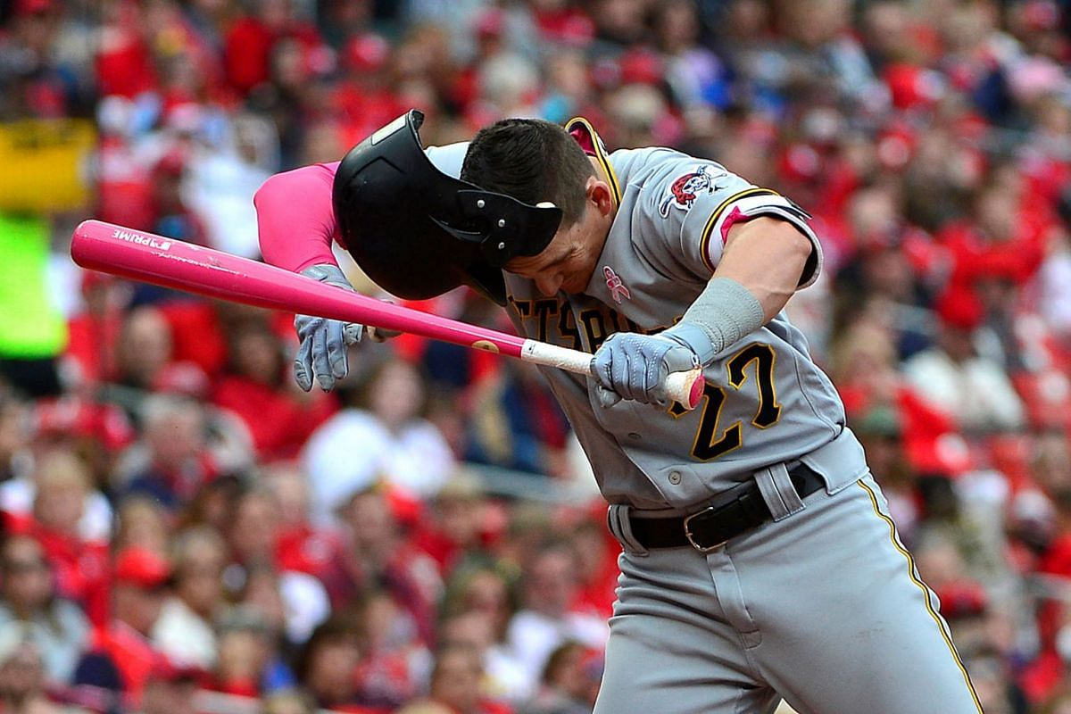 Pittsburgh Pirates second baseman Kevin Newman (27) loses his helmet while avoiding being hit by a pitch during the seventh inning against the St. Louis Cardinals at Busch Stadium on . May 12, 2019 in St. Louis, MO, USA. PHOTO: USA TODAY SPORTS
