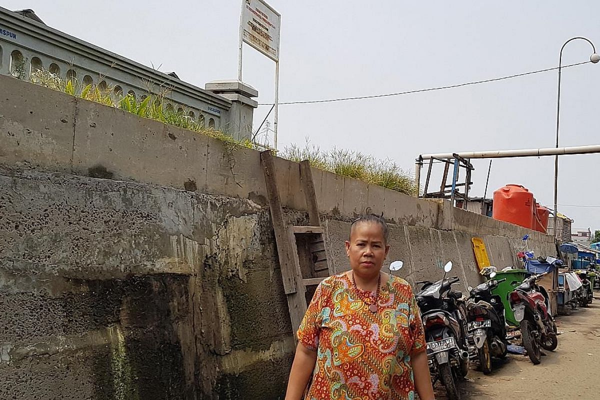 This 2m-high wall helps keep seawater out, but also blocks access to the sea for residents in North Jakarta's Muara Baru neighbourhood. The coastal land is sinking by up to 25cm annually, faster than any other city in the world. As a result, one of A