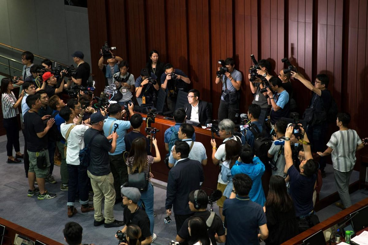 Hong Kong Democratic Party member James To Kun Sun (centre) surrounded by members of the media during the start of a meeting about extradition laws in the Legislative Council in Hong Kong on May 14, 2019.