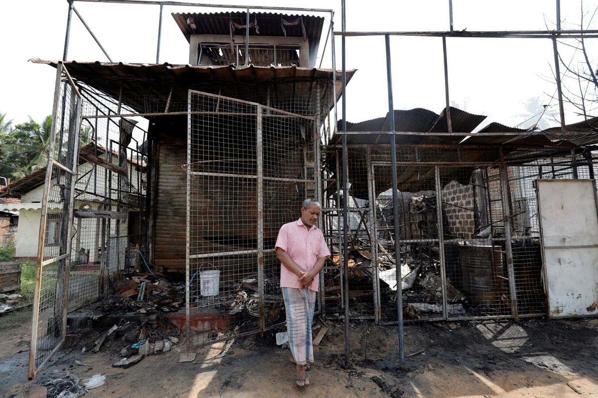 A Muslim man outside what remains of his shop, which was burned down during a mob attack in Kottampitiya, Sri Lanka, on May 14, 2019.