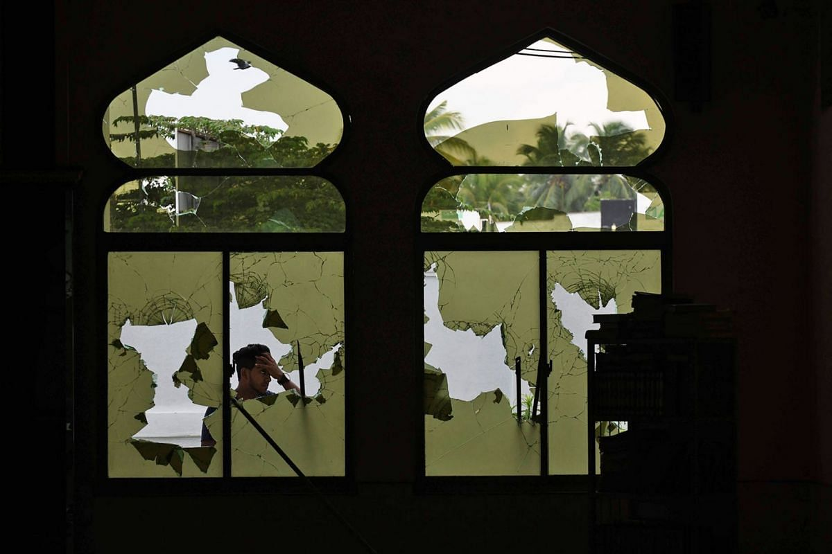 A Muslim man stands in front of the Jumha mosque after a mob attack in Minuwangoda, Sri Lanka, on May 14, 2019. PHOTO: AFP